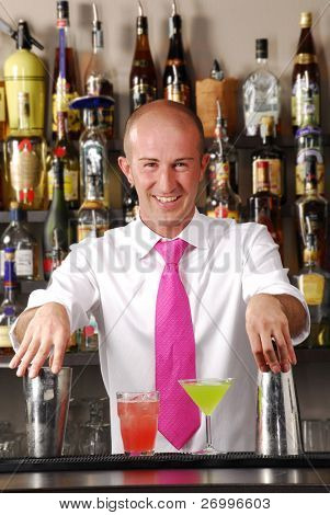Bartender and cocktails. barkeeper and colored cocktails