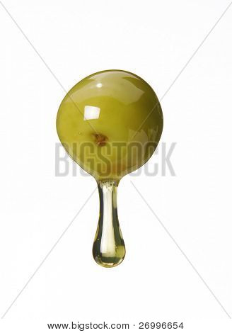 Olive oil pouring from olive.Pouring olive oil,olive oil drop,