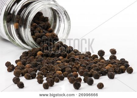 Black peppercorns and pot. Black pepper balls.