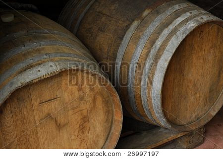 Detail of two red wine fermentation barrels.