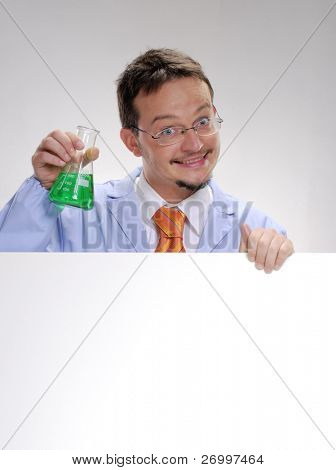 Funny young scientist holding an experimental glass. A doctor holding an experimental formule glass.