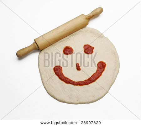 Floured Rolling Pin on Pizza Dough and tomato sauce.