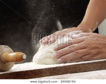 Preparing pizza dough.