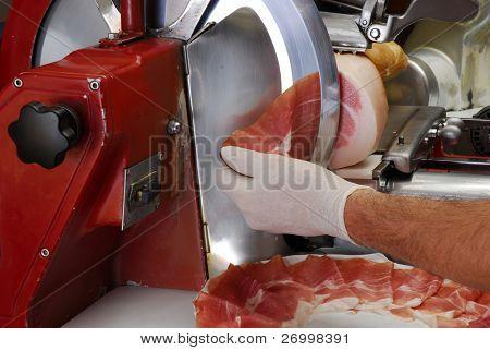 Ham slicer and fresh ham slice.