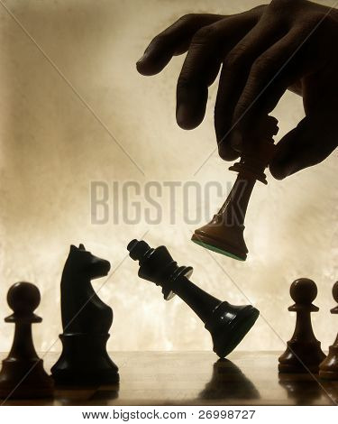 Playing chess game. defeating the Queen.