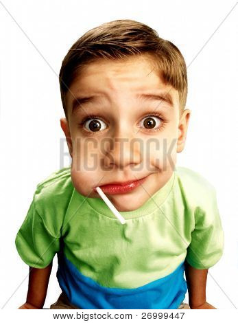 Close up of a young boy eating Lollipop on white background.