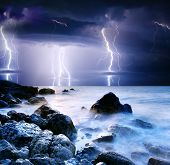image of lightning bolts  - summer storm beginning with lightning - JPG