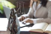 Lawyer Office. Statue Of Justice With Scales And Lawyer Working On A Laptop. Legal Law, Advice And J poster