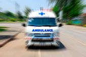 Looking From The Rearview Mirror Ambulance Speeding To Accident, Emergency Ambulance Travels Through poster