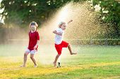 Kids Play With Water. Child With Garden Sprinkler. poster