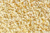 Popcorn, Popped Corn, Surface And Background. Butterfly Shaped Popcorn Puffed Up From The Kernels, A poster
