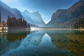 Majestic Mountains Reflected In Water In Beautiful Dobbiaco Lake At Sunny Morning In Autumn.  Fall I poster