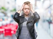 Young blonde woman wearing fashion jacket over isolated background suffering from headache desperate poster