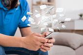 Email Marketing And Newsletter. Guy Using Mobile Phone With E-mail Application poster