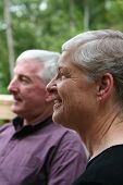 stock photo of senior-citizen  - Happy Senior Couple sitting and smiling outside