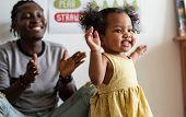 Happy girl and teacher having fun in nursery poster