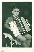 picture of aerophone  - Vintage photo of boy playing an accordion  - JPG
