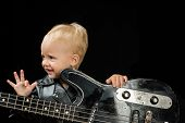Music Is My Escape. Rock And Roll Music Performer. Little Rock Star. Child Boy With Guitar. Little G poster