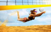 Female volleyball beach  player in action  poster
