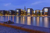 Church Christians Kirke And Waterfront With Its Mirror Reflection In Canal At Night, Copenhagen, Cap poster