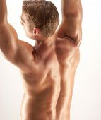 stock photo of jive  - Shaped and young man stretching his muscles - JPG