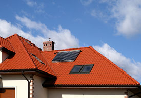 stock photo of red roof  - Beautiful new home with solar panels on the roof  - JPG