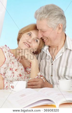 Loving elderly couple resting at home
