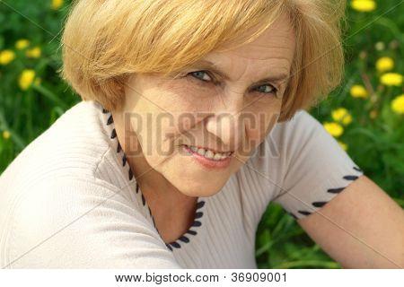 Beauteous lady enjoys union with nature