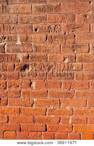 Grungy Brick Wall With Carvings