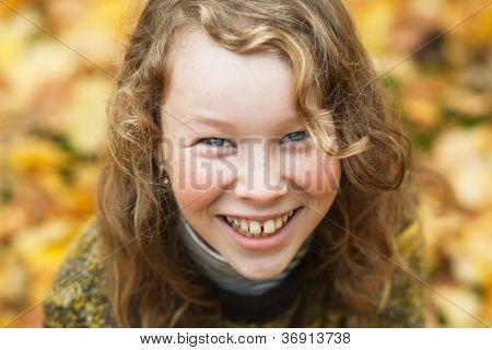 Outdoor High Angle Portrait Of Smiling Blond Girl