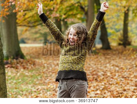 Happy Teenager Girl In Autumn Park