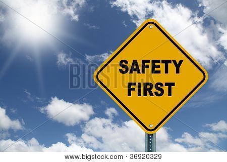 Yellow safety first sign