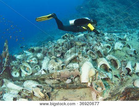 Scuba Diver Exploring Wreckage