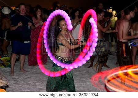 Whirling Dancers And Spectators At A Drum Circle On Siesta Key Near Sarasota, Florida