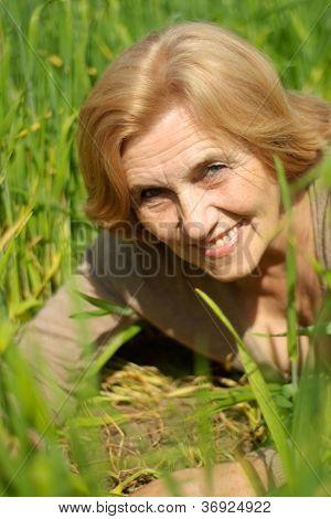 Nice old woman is enjoying the fresh air