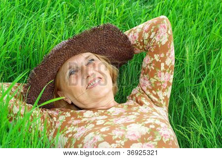 Interesting old woman is enjoying the fresh air