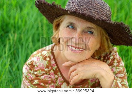 Tender old woman is enjoying the fresh air