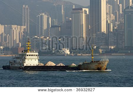 ship passing skyscrapers of Hong Kong