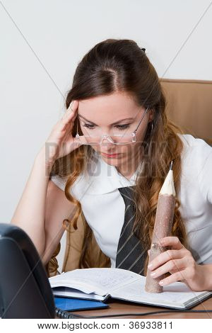 Serious Manager Woman Read The Notes In A Notebook At A Desk In The Office