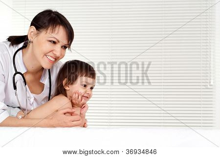 Happy physician with small patient