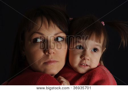 Nice sad Caucasian woman with a daughter