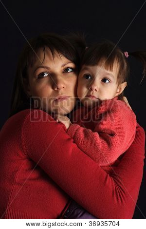 Beautiful sad Caucasian woman with a daughter
