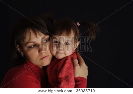 Nice sad Caucasian mother with a daughter