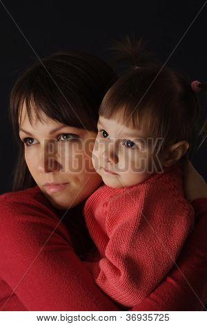Good sad Caucasian mother with a daughter