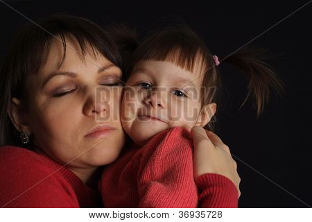 Happy sad Caucasian mother with a daughter