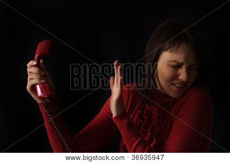 sad Caucasian woman talking on the phone