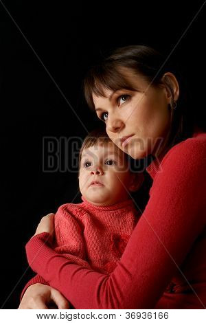 A beautiful Caucasian mom with a sad crying daughter