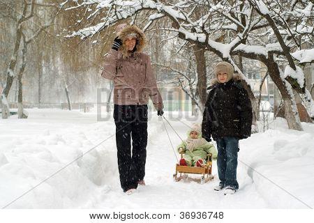 nice family of three people walking