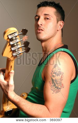 Bass Player With Tattoo