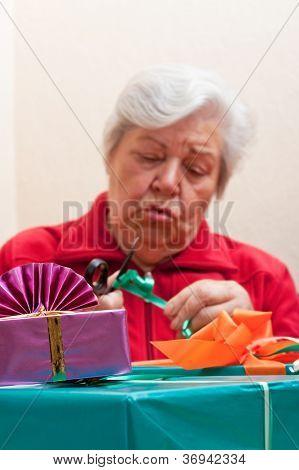 A Senior Citizen Wrap Or Unpack Presents, Closeup